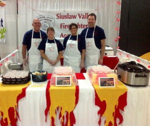 Our team, Greg and Arda Stober, along with my wife and I. Our clear display boxes had small strobe lights covered in red and yellow tissue paper to look like flames. That's just how cool we are.