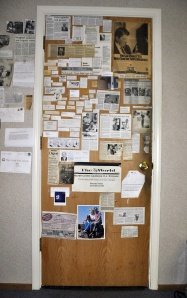 The Door in our newsroom: a sentinel of newspaper clippings, held together by history and a lot of tape.