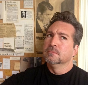 Standing next to The Door in our newsroom, which is the only thing here older than me... wait, is Ronald Reagan smelling my hair?