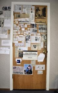 The Door, serving as journalistic sentinel and restroom door.