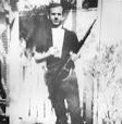 Lee Harvey Oswald with his rifle and two tickets to that weekend's Cowboys game