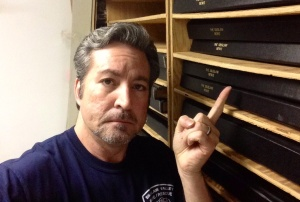 """Pointing at a random newspaper archive in """"The Morgue"""" for added drama."""