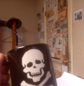 Raising my mug to The Door from my vantage point behind my desk — and hoping no one uses the commode this morning.