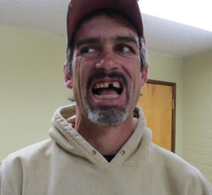 I'm not sure if he is smiling or reacting to a cavity search. And I'm not talking about his teeth...