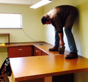 The first step was to divide the cabinets into sections. The second step was to remember NOT to stand on the side that was going to fall away after being sawed through...