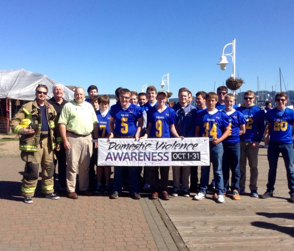 Representing my fellow fire department volunteers, along with Siuslaw Outreach Services executive director David Wiegan, assistant football coach Bob Teeter and team members, we march to show support for victims of abuse and the importance of awareness in every community.