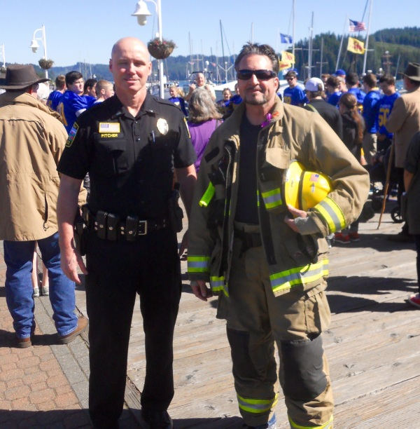 With Lt. John Pitcher at this year's march. We may not agree on what's better, donuts or 5-alarm chili, but ending domestic violence is definitely common ground...