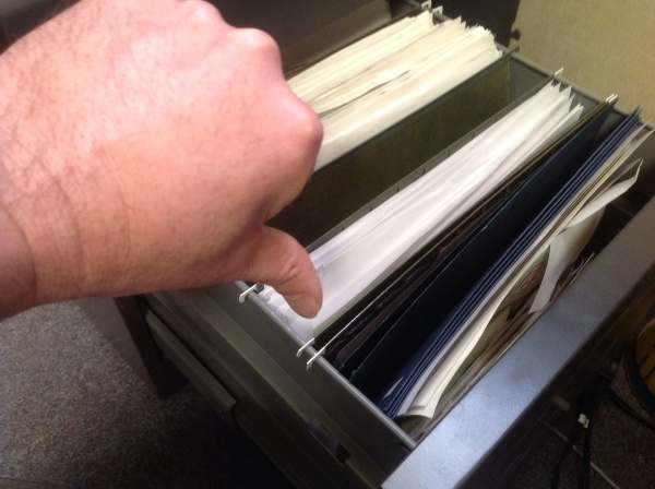 "My ""thumbs down,"" pointing to the file of rejection letters in my drawer. In firefighting, we call them ""fuel load."""